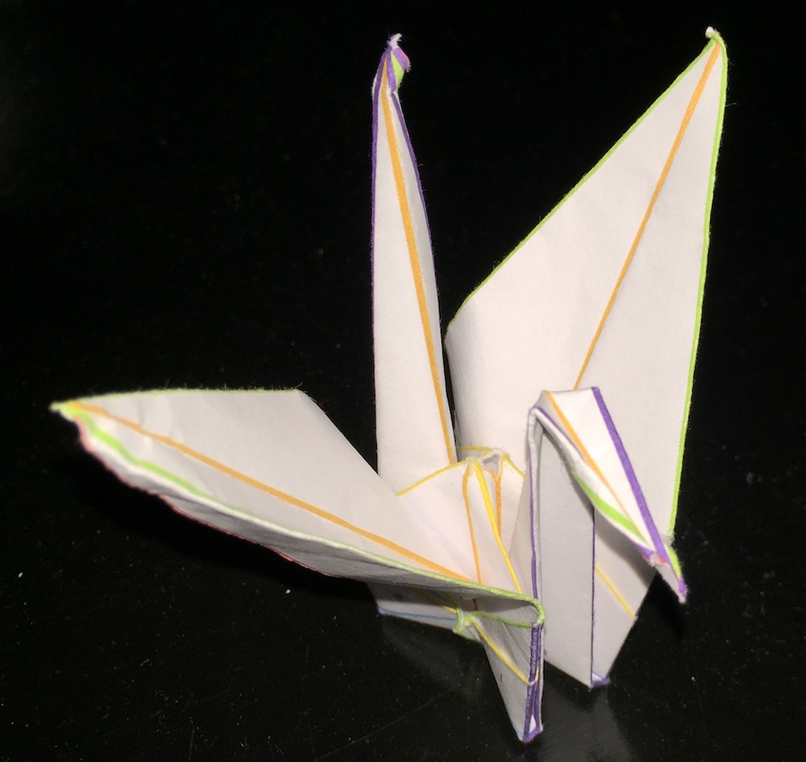 the second image folded to form a crane